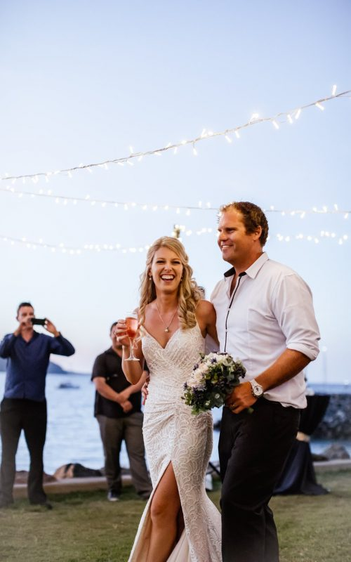 Bride-And-Groom-Arriving-To-Whitsunday-Wedding-Reception